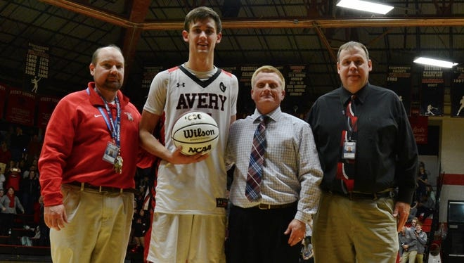 Avery County senior Jeffrey Puckett scored his 1,000th career point in Tuesday's 71-57 win over visiting Hendersonville.