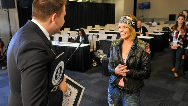 Miranda Lambert is surprised to receive a Guinness World Record certificate for most consecutive ACM female vocalist of the year wins at rehearsals for the 50th Academy of Country Music Awards.