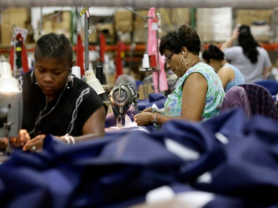 Sewing machine operators assemble U.S. flags at Annin