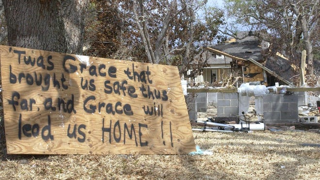 Beach Boulevard residents leave messages at the site of their destroyed homes in Pascagoula in 2005.