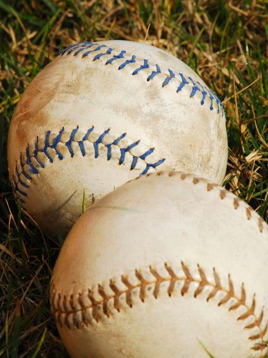 636612493667321907-softballs-in-grass---vertical.jpg