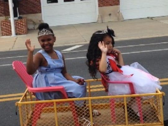 In this May 9, 2015 photo, pageant queens take a wagon