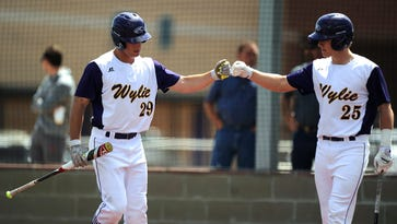 Wylie's Cameron Hanna (29) is congratulated by teammate Caleb Munton (25) after Hanna scored a run in the bottom of the second inning of Wylie's 12-2 win on Saturday, March 18 2017, at Wylie High School.