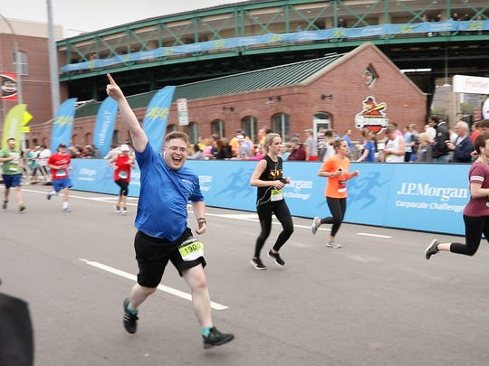 File Photo: Scenes from the J.P. Morgan Corporate Challenge in downtown Rochester.