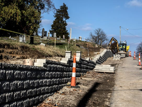 Construction crews continue work on a new retaining
