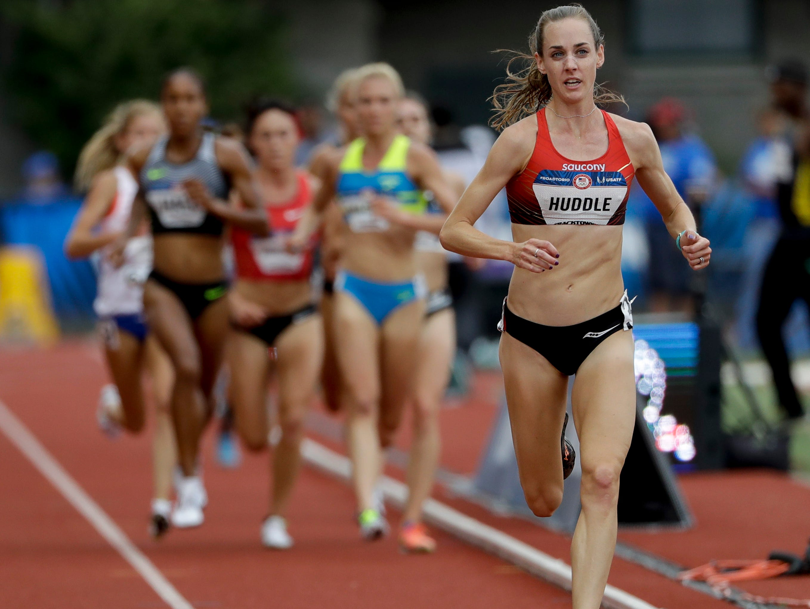 Molly Huddle sets the pace, while former Fort Collins High standout Katie Mackey leads the pack chasing her in the the second of two qualifying heats of the women's 5,000 meters Thursday night at the U.S. Olympic Trials in Eugene, Ore. Huddle and Mackey went 1-2 in the heat while turning in the top qualifying times for Sunday night's final.