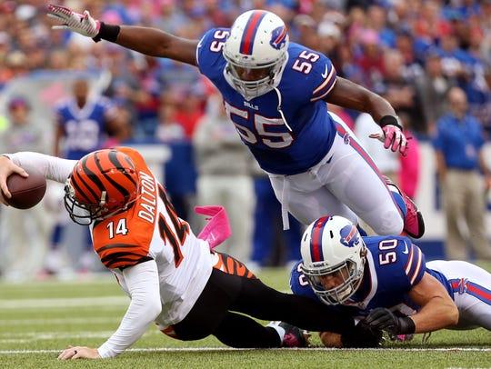 Bills defensive end Jerry Hughes, top, has been getting