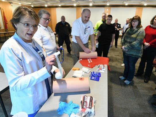 Debi Tuggle, left, RN with UT Medical Center, leads