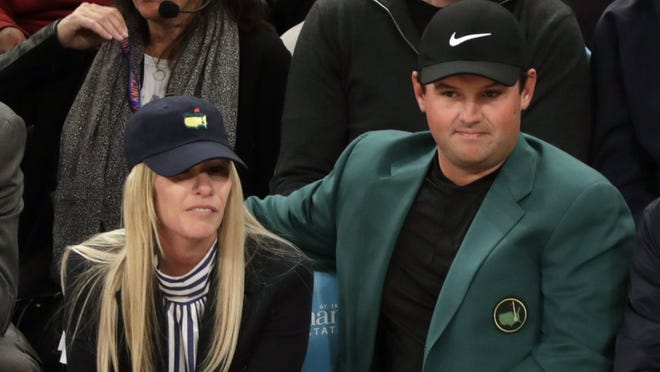 epa06658080 Masters champion Patrick Reed of the USA (R) and his wife Justine (L) watch the NBA basketball game between the Cleveland Cavaliers and the New York Knicks at Madison Square Garden in New York, New York, USA, 09 April 2018.  EPA-EFE/JASON SZENES SHUTTERSTOCK OUT ORG XMIT: JSX04