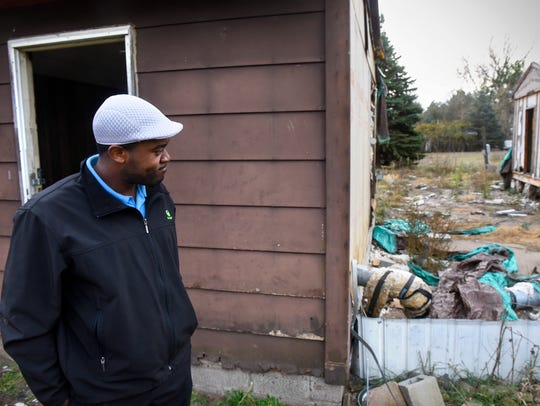 Mike Nwachukwu looks at a section of property he purchased