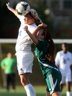 Union Catholic's Morgan Sosnowski beats Rebecca DelRio of Kent Place to a first half header, Thursday, October 16, 2014, in Scotch Plains, NJ, a game in which Union Catholic coach Jim Revel notched his 400th career victory.  Jason Towlen/STAFF PHOTO