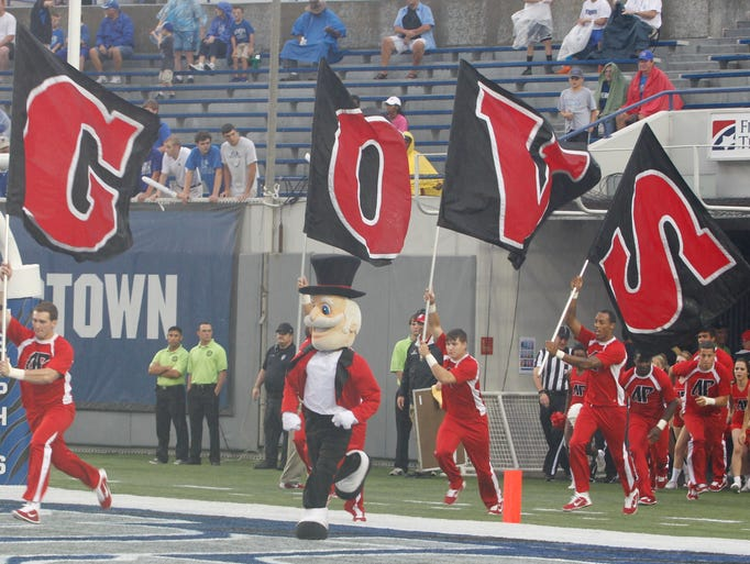 Austin Peay fans, cheerleaders watch as Austin Peay lost to Memphis 63-0 during the season opener at the Liberty Bowl in Memphis.