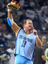 In this April 23, 2011, file photo, professional wrestler