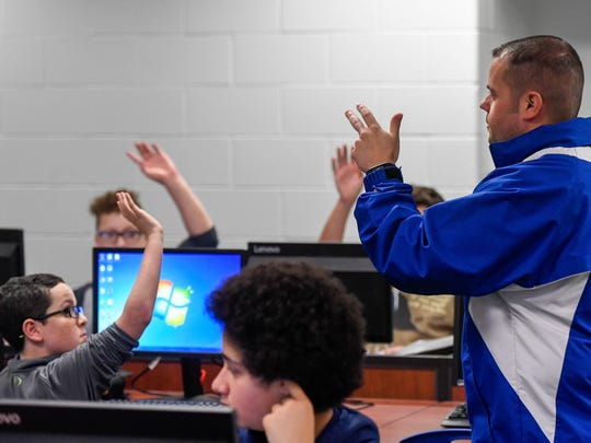Castle North Middle School teacher Josh Watjen answers questions about a class project researching a list of questions from his seventh grade science class.
