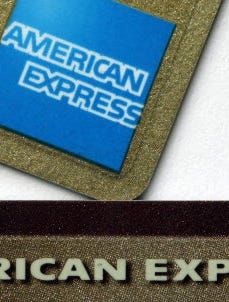 Two American Express credit cards shown in Surfside, Fla., file photo