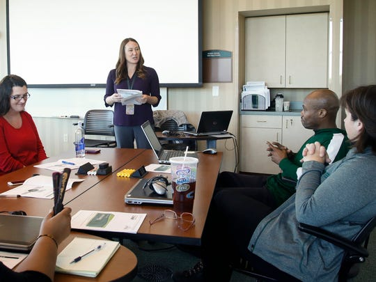 Jen Branch trains new employees Thursday, Nov. 10, 2016, at the MSUFCU Headquarters in East Lansing.