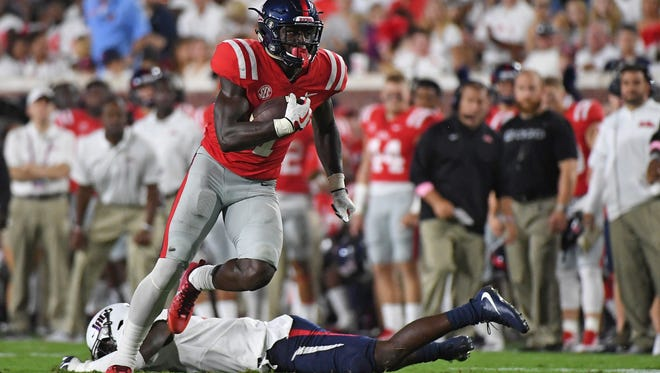 Mississippi wide receiver A.J. Brown (1) runs the ball past South Alabama safety Nigel Lawrence (6) during the first half of an NCAA college football game in Oxford, Miss., Saturday, Sept. 2, 2017. (AP Photo/Thomas Graning)