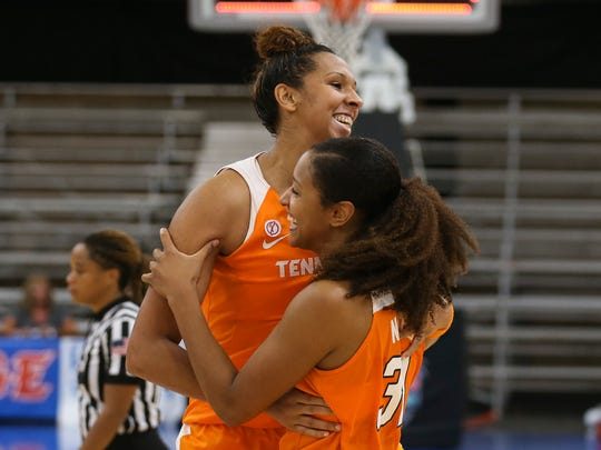 Tennessee seniors Mercedes Russell, left, and Jaime Nared celebrate after the Lady Vols' victory over Marquette to open the Cancun Challenge