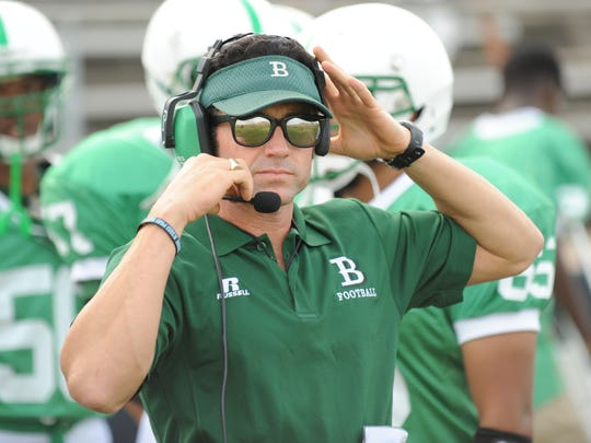 Bossier football head coach Michael Concilio watches from the sideline as his team takes on Plain Dealing at the Bossier Parish football jamboree.