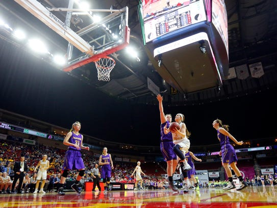 Regina's Mary Crompton drives to the basket during