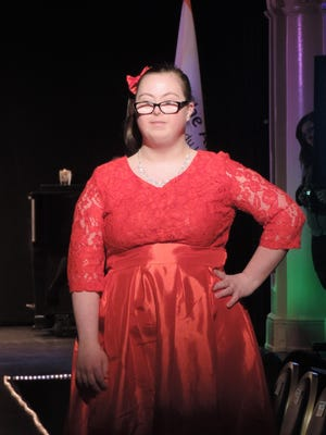 Model Emily Jandura struts down the catwalk during the disability awareness fashion show held March 15.
