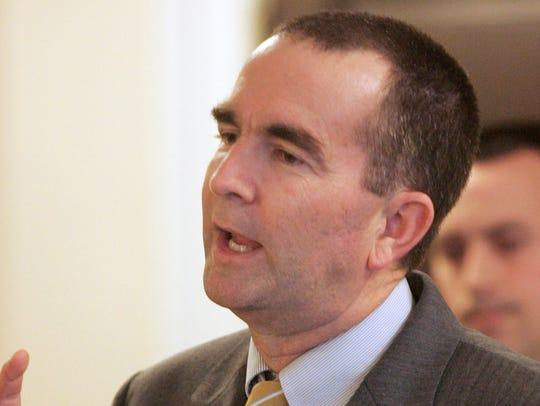 State Sen. Ralph Northam, D-Norfolk, gestures during