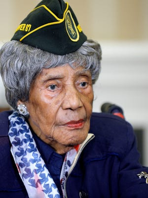 The oldest living woman veteran, 110-year-old Emma Didlake stands in the Oval Office of the White House during a meeting with U.S. President Barack Obama on July 17. She died Sunday.