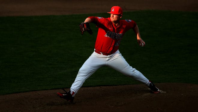 Arizona starter JC Cloney (27) pitches out of the last shaft of the day's sunlight against UC Santa Barbara in their elimination game at the College World Series at TD Amiertrade Park, Wednesday, June 22, 2016, Omaha, Neb.