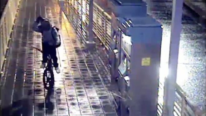 Phoenix have released surveillance video of a man believed to have shot two people at a light-rail platform.