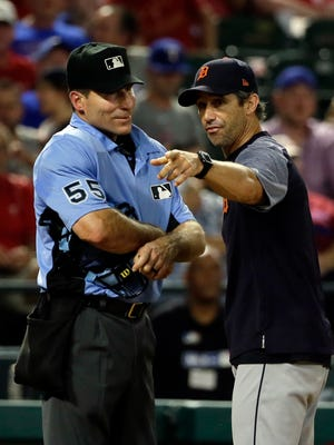 Home plate umpire Angel Hernandez (55) listens as Tigers manager Brad Ausmus, right, argues with Hernandez after Ian Kinsler was ejected in the fifth inning on Monday, Aug. 14, 2017, in Arlington, Texas.