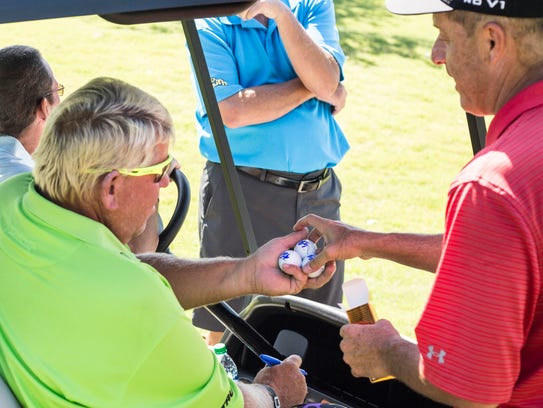 John Daly hands signed balls to Paul Fryman during Monday's Danny Thomas Pro-Am at the 2018 FedEx St. Jude Classic at TPC Southwind.