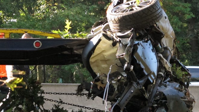 This Oct. 8, 2012 file photo shows the wrecked Subaru Impreza in which four people died as it is loaded onto a flatbed truck on the Southern State Parkway in West Hempstead, N.Y., after and early-morning accident. At the wheel was a New York teenager, Joseph Beer, who had smoked about $20 worth of marijuana, before getting into the car with four friends, and driving over 100 mph before crashing into trees with such force that it split the car in half. As states liberalize their marijuana laws, public officials and safety advocates worry that more drivers high on pot will lead to a spike in traffic deaths. Researchers who have studied the issue, though, are divided over whether toking before taking the wheel in fact leads to more accidents.