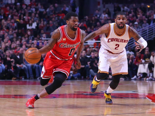 Apr 9, 2016; Chicago, IL, USA; Chicago Bulls guard Aaron Brooks (0) drives around Cleveland Cavaliers guard Kyrie Irving (2) during the first half at the United Center. Mandatory Credit: Dennis Wierzbicki-USA TODAY Sports
