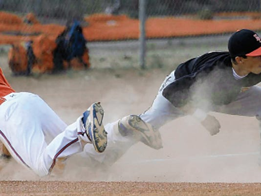 VICTOR CALZADA-EL PASO TIMES El Paso third baseman  reaches for a throw as Canutillo's Angel Frausto slides in safely Tuesday.