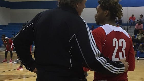 North Caddo coach Ron Meikle visits with Darriun rice during Friday's game at Southwood.