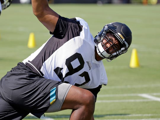 Jacksonville Jaguars defensive lineman Calais Campbell warms up during NFL football training camp, Friday, July 28, 2017, in Jacksonville, Fla.
