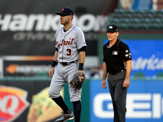 Tigers second baseman Ian Kinsler (3) stands by second