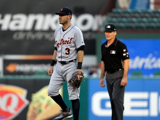 Tigers second baseman Ian Kinsler (3) stands by second as umpire Angel Hernandez, right, watches play during the second inning on Wednesday, Aug. 16, 2017, in Arlington, Texas.