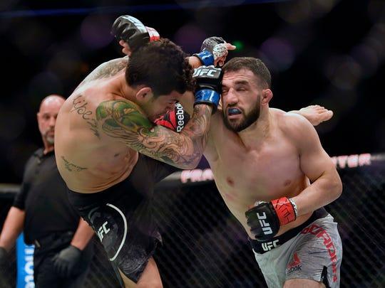 Jared Gordon, right, fights Carlos Diego Ferreira during UFC Fight Night at Frank Erwin Center.