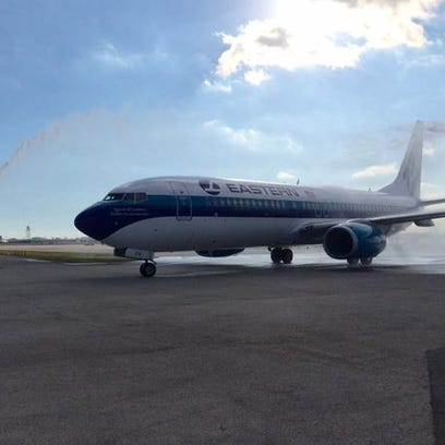 The first aircraft for a re-launched version of Eastern Airlines receives a water-cannon salute at Miami International Airport on Dec. 19, 2014.