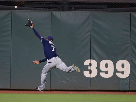 San Diego Padres center fielder Manuel Margot can't make the catch on a double by San Francisco Giants' Buster Posey during the first inning of a baseball game Friday, Sept. 29, 2017, in San Francisco. (AP Photo/Tony Avelar)