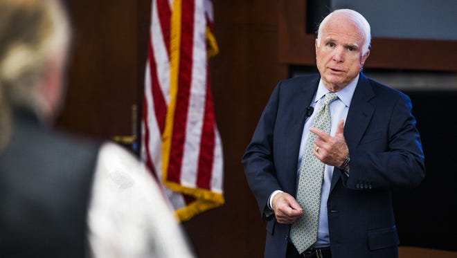 Sen. John McCain answers a question during a town hall in Scottsdale in August 2015. He and others are taking steps to avoid disruptions by protesters at events.