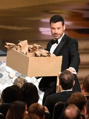 Host Jimmy Kimmel distributes sandwiches at the 68th Primetime Emmy Awards on Sunday, Sept. 18, 2016, at the Microsoft Theater in Los Angeles.