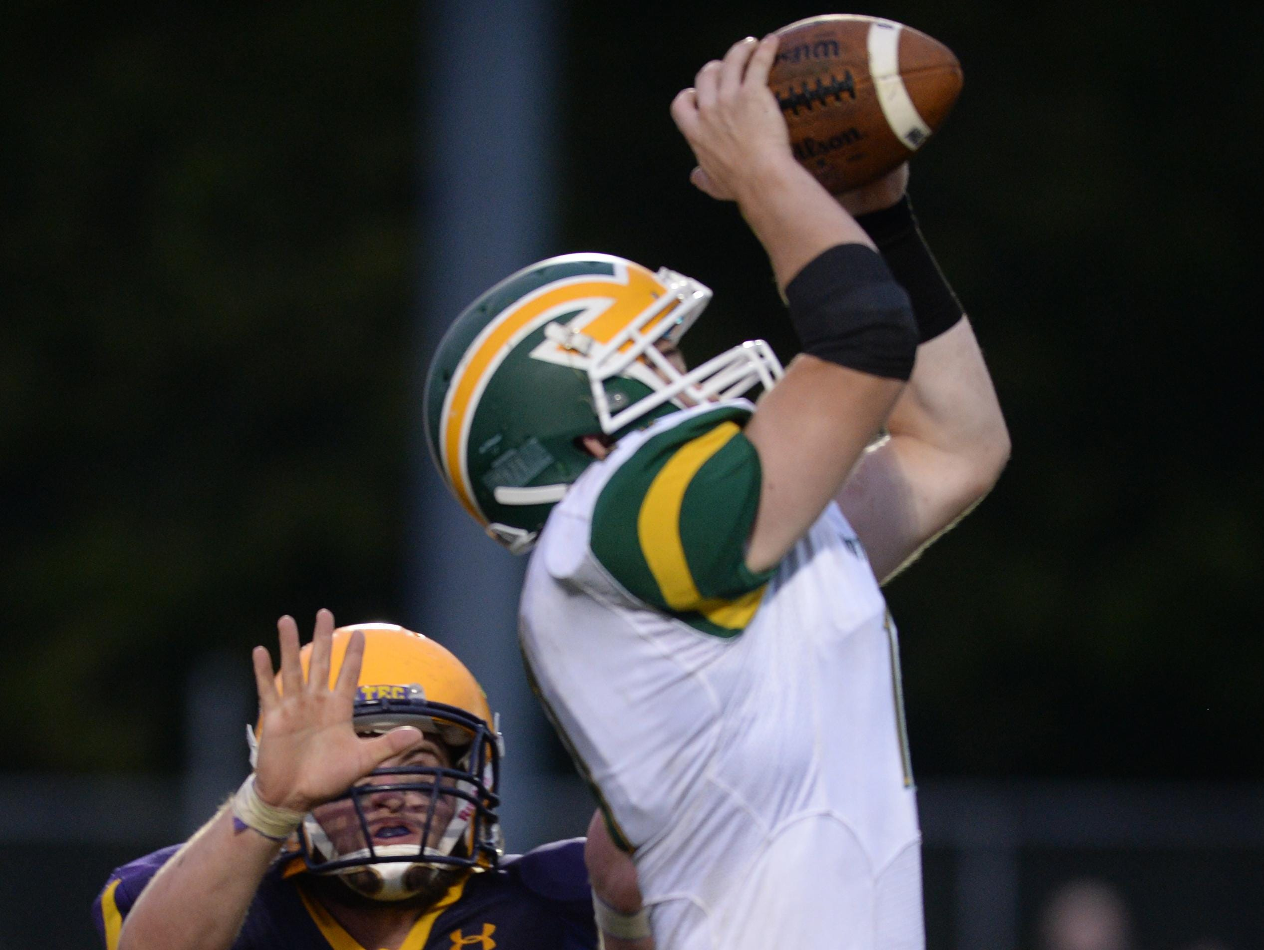 Northeastern's Jacob Slinker intercepts a pass intended for Hagerstown's Dylan Woolard during a football game Friday, Sept. 11, 2015, in Hagerstown.