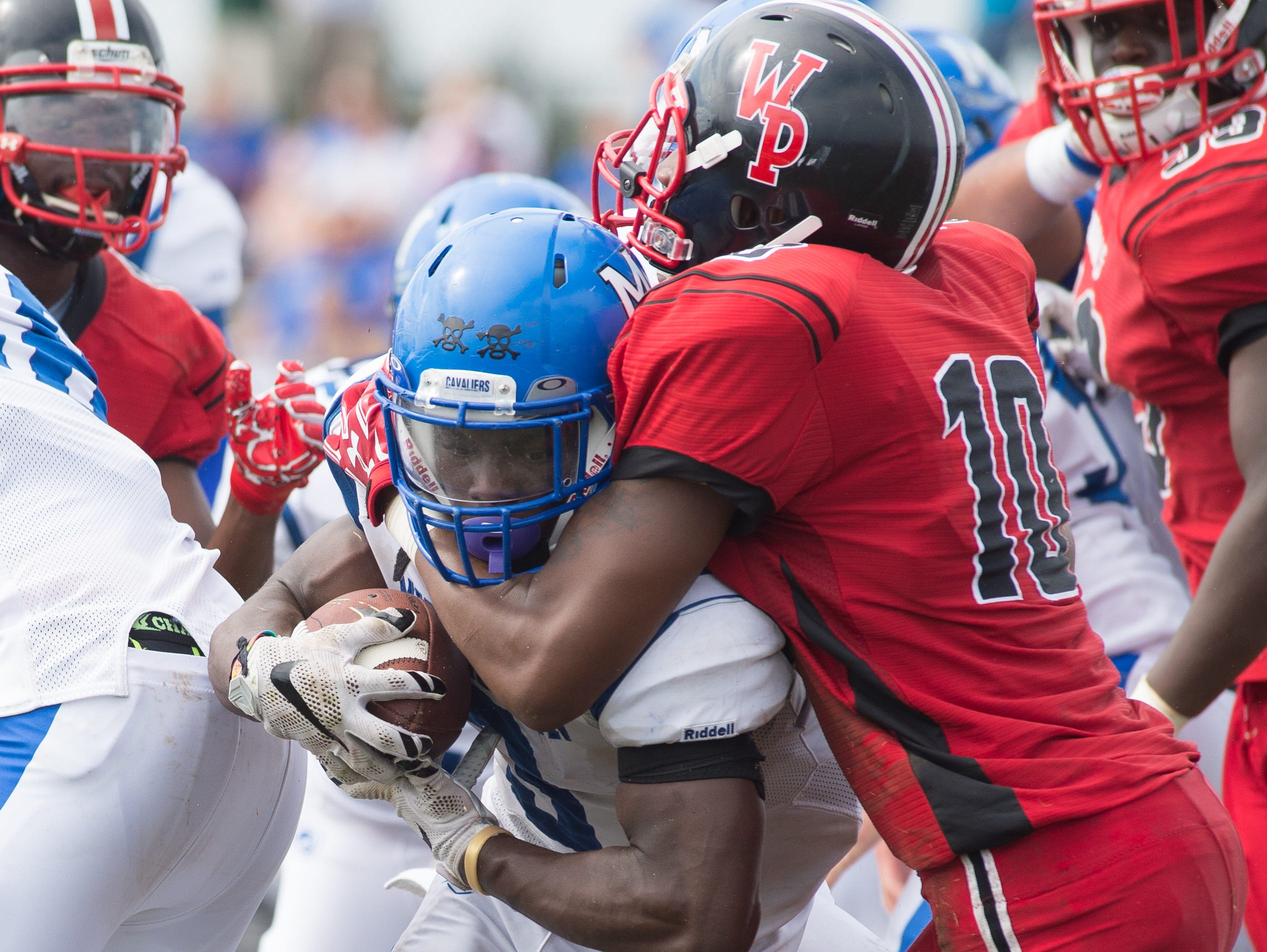 Middletown's Kedrick Whitehead (3) with a touchdown run to make the score 19-0 in their game against William Penn.