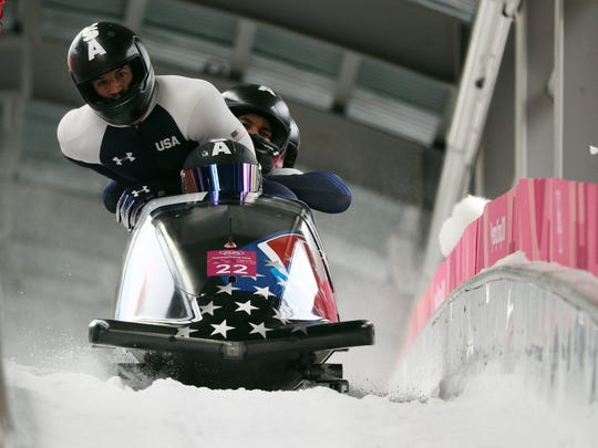 Nick Cunningham, Hakeem Abdul-Saboor, Christopher Kinney and Samuel Michener (USA) compete in the open 4-man competition run 2 during the Pyeongchang 2018 Olympic Winter Games at Olympic Sliding Centre.