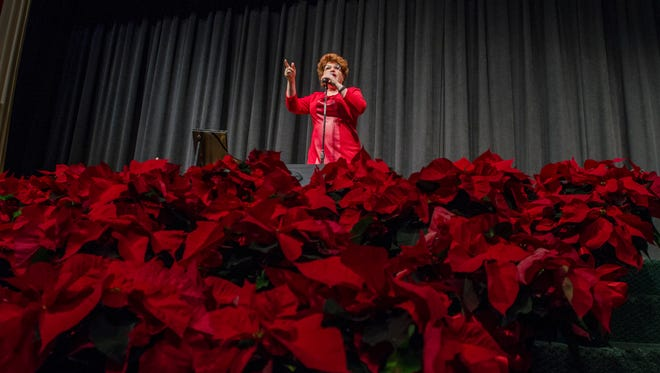 Singer and comedienne Klea Blackhurt addresses the audience Monday, Dec. 12, at the Town Hall lecture series at McMorran Theatre.