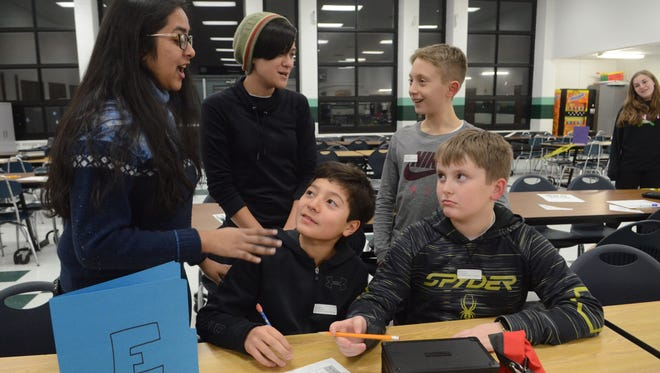 STEM Night held at Kinnelon's Pearl R. Miller School, encouraged creative thinking. Pictured are facilitators Meshna Sen and Rhianna Jennings with Juan Perez, Christian Cerulo and George Gillen.