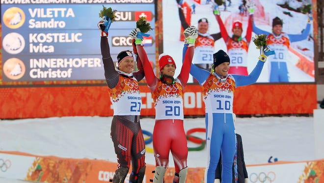 Silver medalist Ivica Kostelic, at left, celebrates with gold medialist Sandro Viletta and bronze medalist Christof Innerhoffer.
