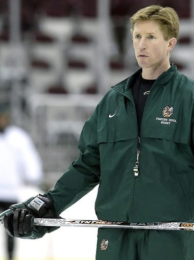 North Dakota coach Dave Hakstol watches his team practice Friday April 8, 2005, in Columbus, Ohio. North Dakota will face Denver in the NCAA Championship on Saturday. (AP Photo/Jay LaPrete)